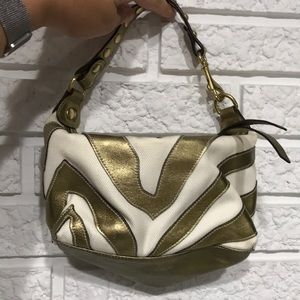 Gold and cream colored COACH bag